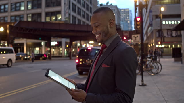 Businessman receiving good news on digital tablet