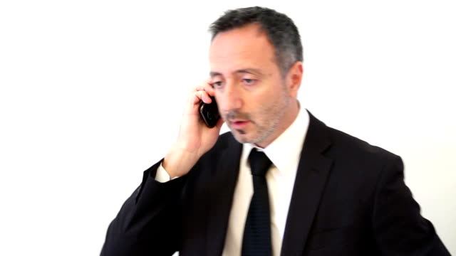 Businessman receiving phone call and rejoices