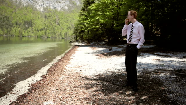 hd: businessman relaxing by the lake - only men stock videos & royalty-free footage