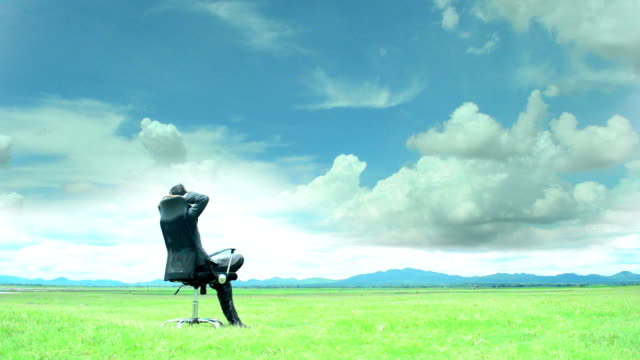 businessman  relaxing with cloud sky moving