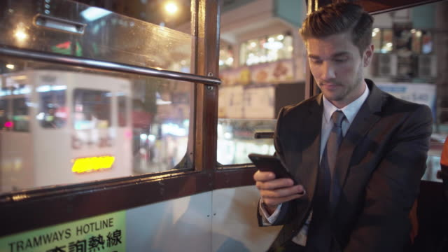 MS businessman riding in a trolly, Hong Kong