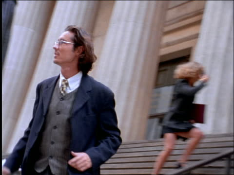 pan businessman running down steps of nyc building - one mid adult man only stock videos & royalty-free footage