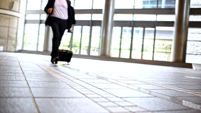 Businessman running through lobby