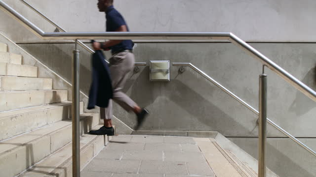 businessman running up stairs in the city - formal businesswear stock videos & royalty-free footage
