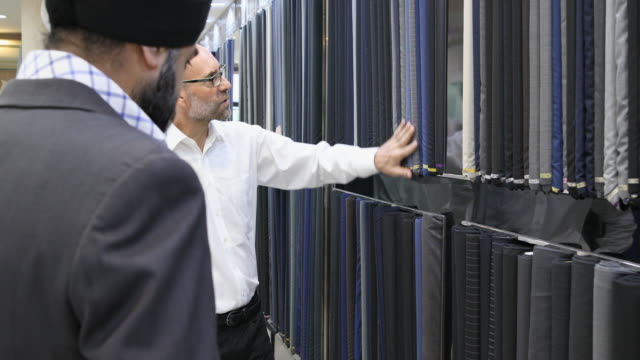 Businessman Selecting Fabric for a Custom Made Suit