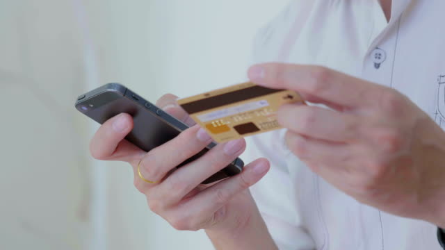 businessman shopping online on mobile phone,close-up - pin entry stock videos & royalty-free footage