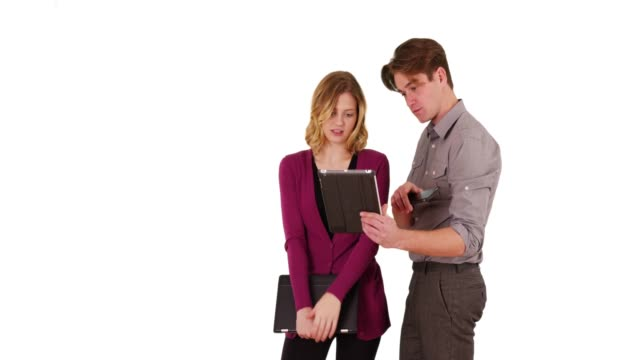 businessman showing female coworker something on tablet in studio with copyspace - touchpad stock videos & royalty-free footage