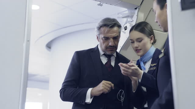 businessman showing his boarding pass to the flight attendant and there is a problem with the boarding pass. - crew stock videos & royalty-free footage