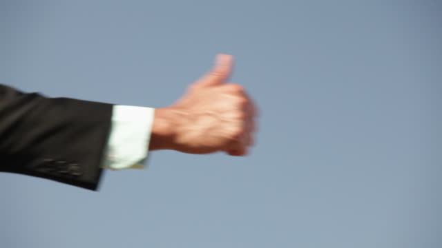 businessman showing thumb  - thumbs up stock videos & royalty-free footage