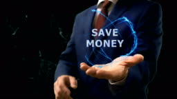Businessman shows concept hologram Save money on his hand