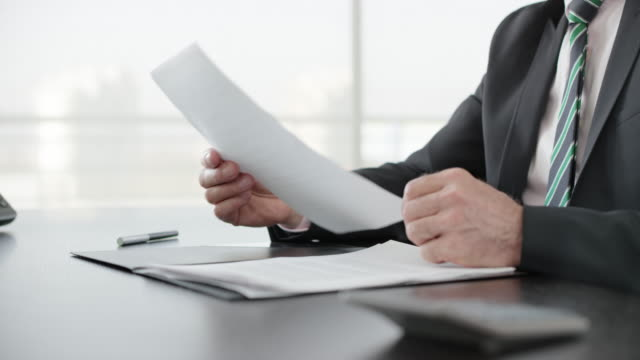 businessman signing a document in his office - document stock videos & royalty-free footage