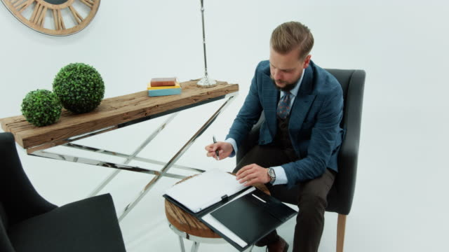 businessman signing contract paper on desk - studio shot stock videos & royalty-free footage