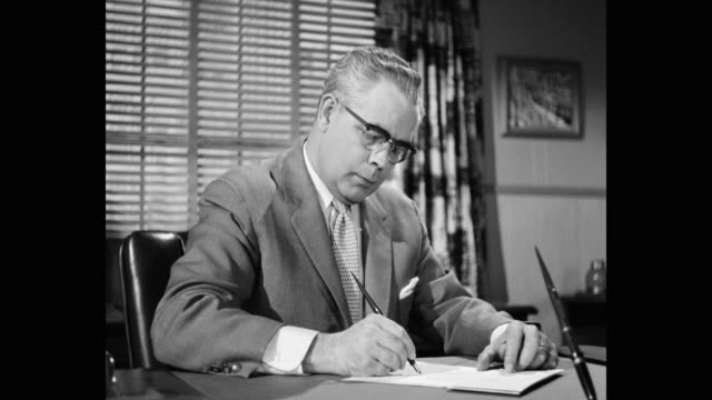 businessman signing documents in office - 1950 stock videos & royalty-free footage