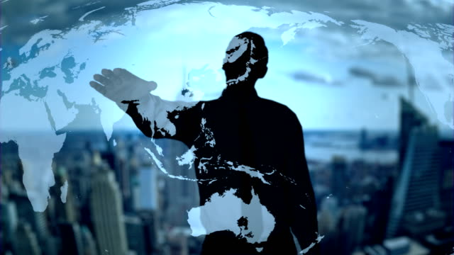 Businessman silhouette using holographic earth map interface technology - Loop