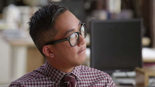 MS Businessman sitting in discussion with coworkers in office
