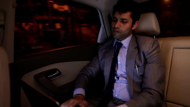 businessman sitting in the car, delhi, india - passenger stock videos & royalty-free footage