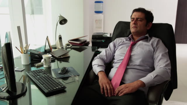 businessman sleeping in an office  - indian ethnicity stock videos & royalty-free footage