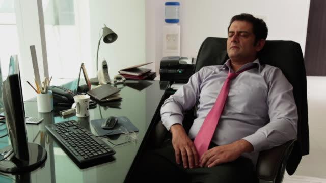 Businessman sleeping in an office