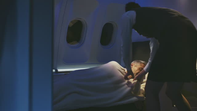 businessman sleeping in private airplane - air stewardess stock videos & royalty-free footage