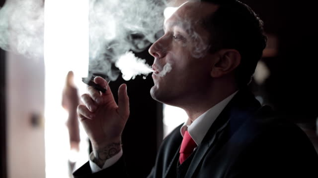 businessman smoking cigar - smoking issues stock videos & royalty-free footage