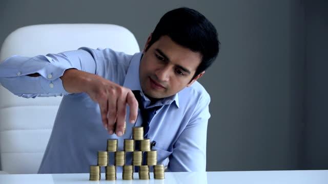 businessman stacking coins, delhi, india - hemd und krawatte stock-videos und b-roll-filmmaterial