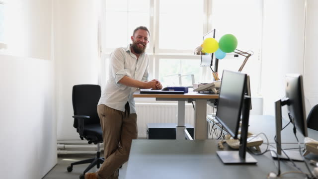 businessman standing at ergonomic desk in office - new business stock videos & royalty-free footage