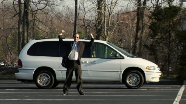 ws, businessman standing beside mini van on parking lot and cheering, upper saddle river, new jersey, usa - people carrier stock videos & royalty-free footage