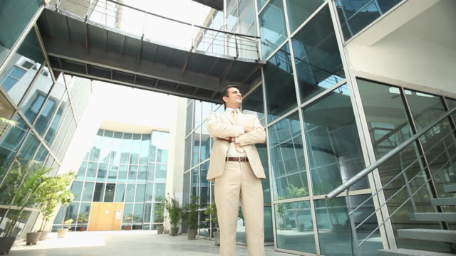 Businessman standing in an office courtyard