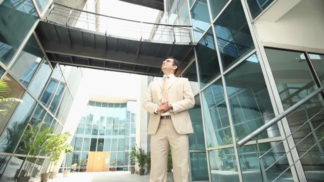 Businessman standing in an office courtyard