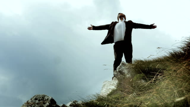HD: Businessman Standing On The Cliff