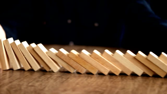 businessman stop domino effect. risk management and insurance concept - risk stock videos & royalty-free footage