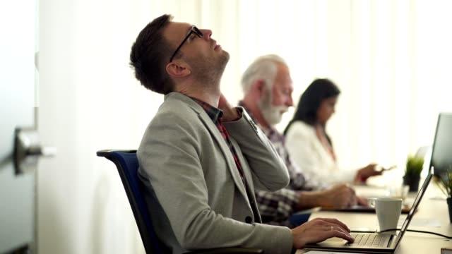 businessman suffering from neckache - neckache stock videos & royalty-free footage