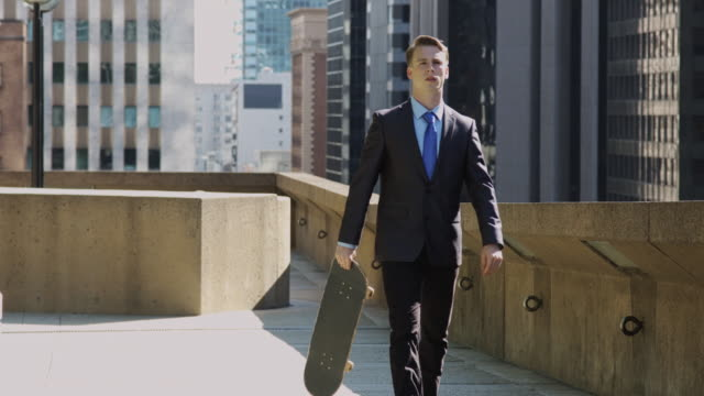 Businessman Swinging Skateboard