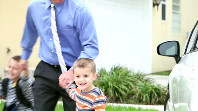 businessman taking boys to school - single father stock videos & royalty-free footage