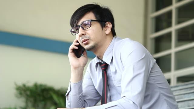 HD : Businessman talking a mobile