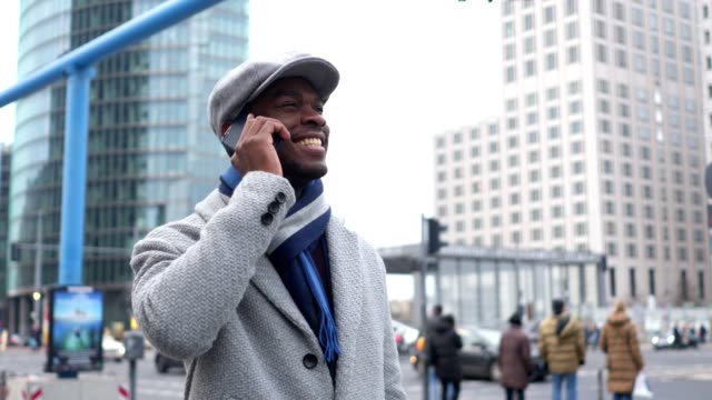 businessman talking on a mobile phone on the street - winter coat stock videos & royalty-free footage
