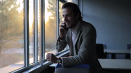 Businessman talking on mobile in office