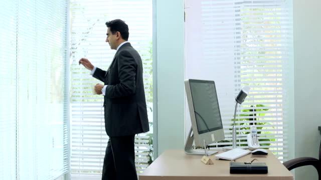 Businessman talking on mobile phone, Delhi, India