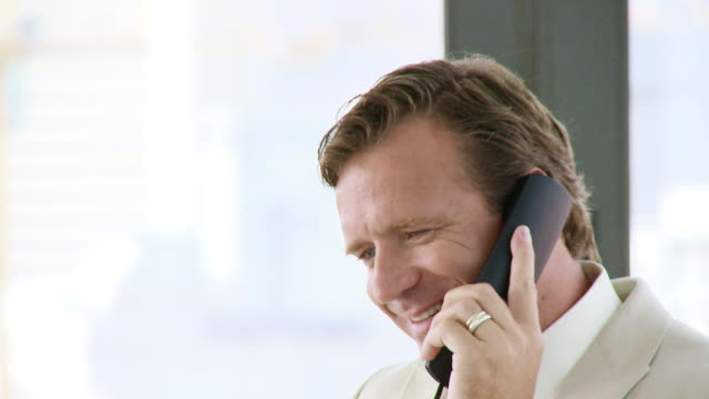 CU Businessman talking on phone, Cape Town, South Africa