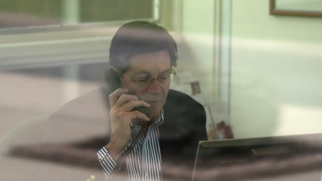 CU Businessman talking on phone in office, Bethlehem, Pennsylvania, USA