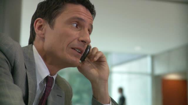 CU TU TD R/F Businessman talking on phone / South Orange, New Jersey, USA