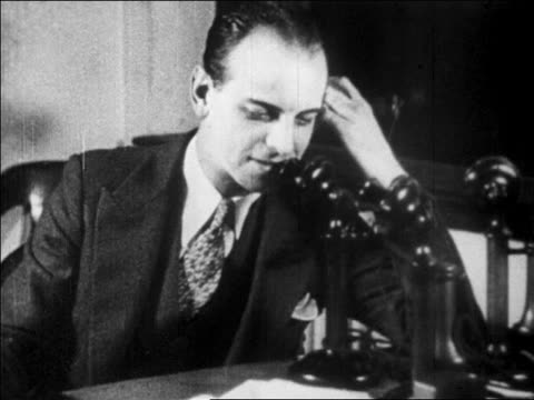vídeos y material grabado en eventos de stock de b/w 1929 businessman talking on telephone in office / newsreel - vestimenta de negocios formal