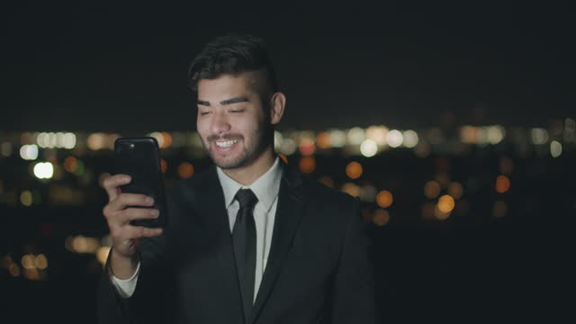 businessman talking on the phone at night - brown hair stock videos & royalty-free footage