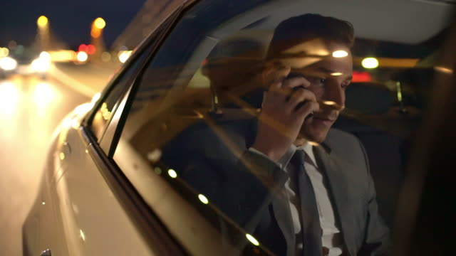 ms businessman talking on the phone in a limousine - corporate business stock videos & royalty-free footage