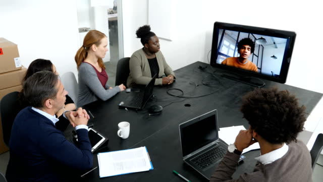 businessman talking through video call in meeting - video conference stock videos & royalty-free footage