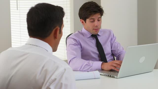 businessman talking to a customer