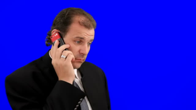 Businessman talks on phone