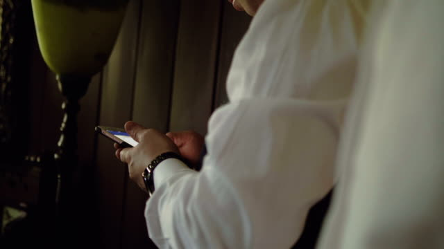 businessman texting on cell phone - only mature men stock videos & royalty-free footage