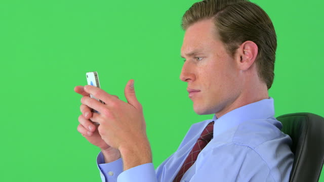 businessman texting on greenscreen