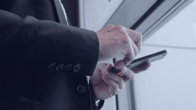 Businessman Texting on Smartphone